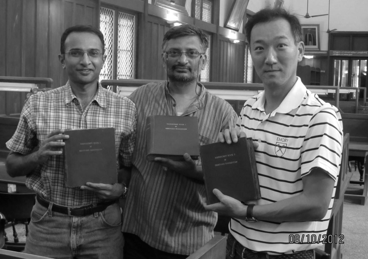 (L to R) Prof Raghuram, IISER Pune, Dr TV Venkateswran, Vigyan Prasar and Prof Ken Ono, Emory College USA holding the original copy of the three Ramanujan note books.jpg